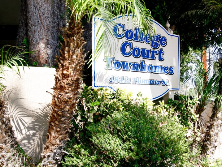 The welcoming sign for College Court Townhomes