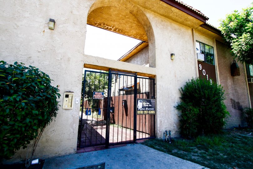 The gated entrance into Cedros South Townhomes in Panorama City California