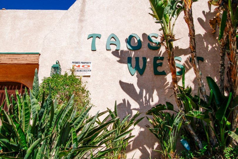 The Taos West name written on the building