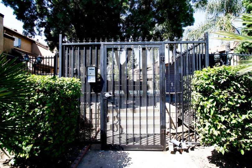 The gated entrance into Woodman Townhomes in Panorama City California