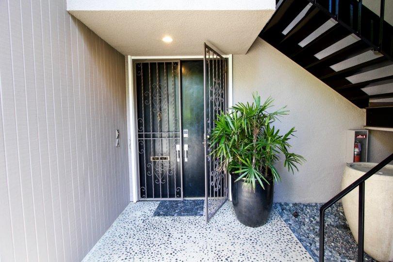 The door leading into 900 S Orange Grove Blvd