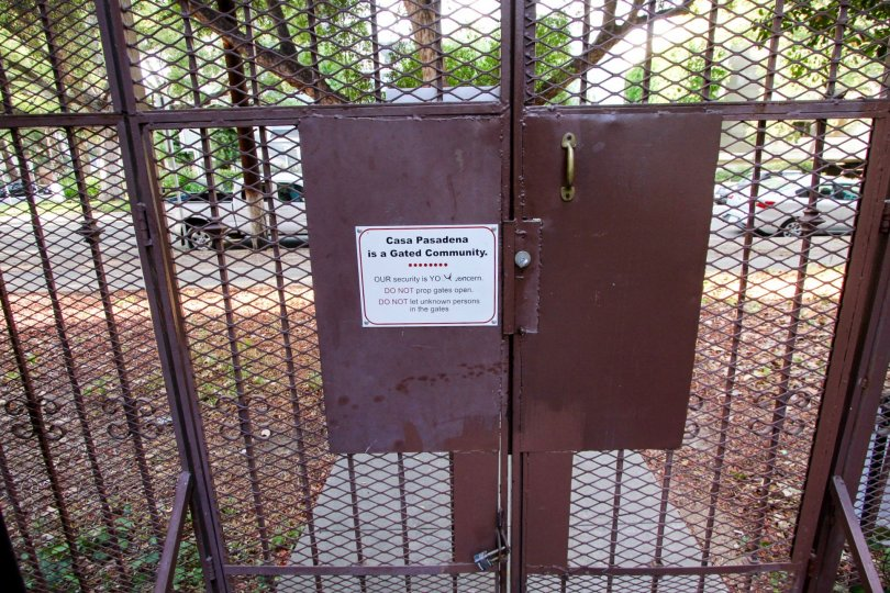 The locked gate to access Casa Pasadena