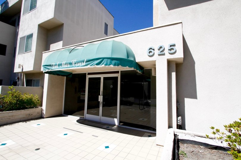 The address for Del Mar Court on the building