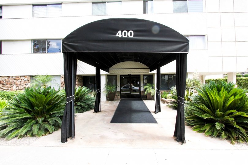 The address for Los Robles Condominiums at the entrance
