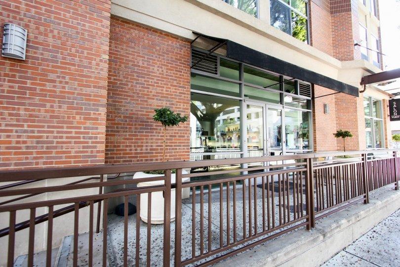 The railing around the entrance into Prado on Lake Avenue