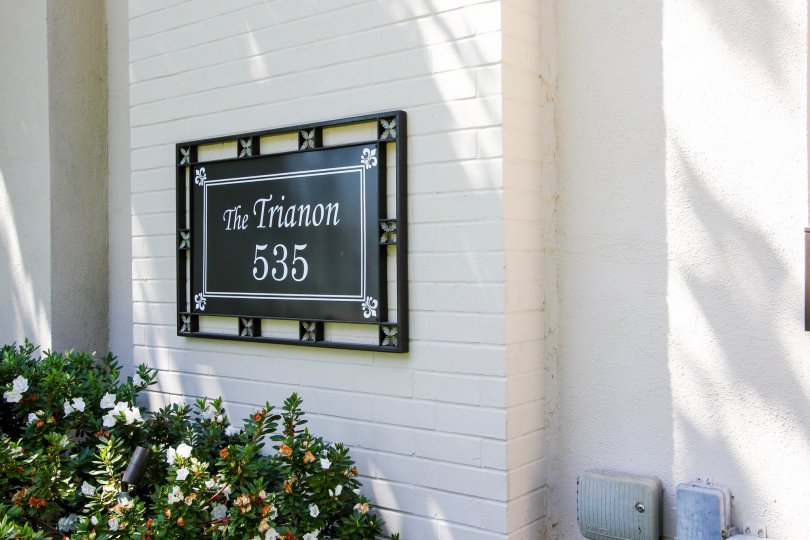 The plaque with the name and address of the Trianon