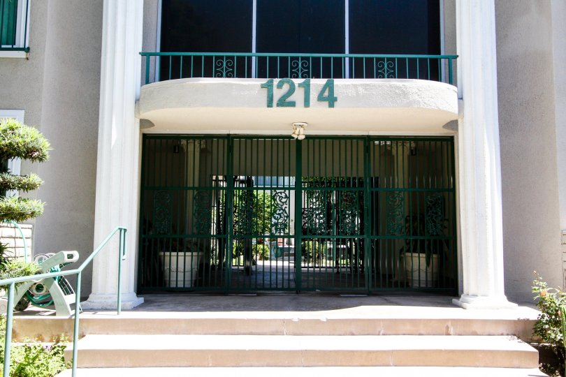The address for 1214 S Alma St above the entrance