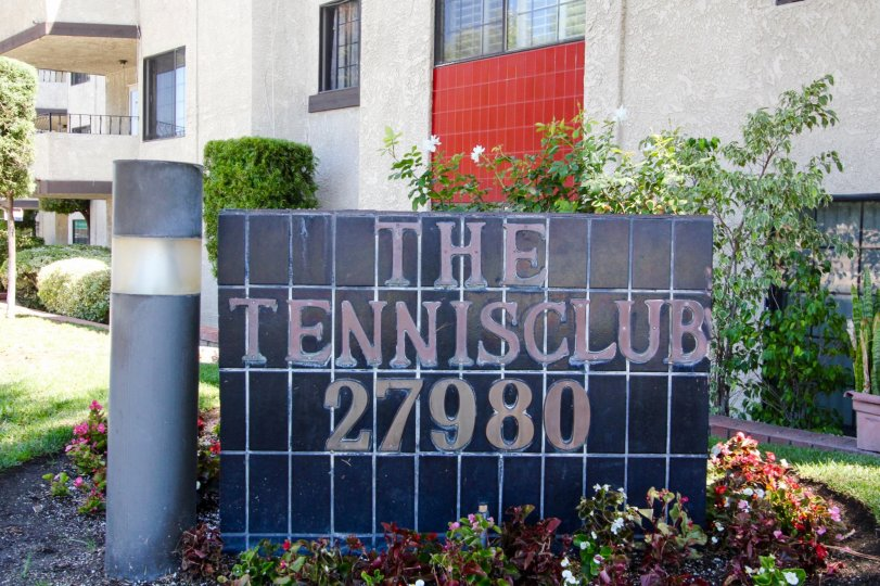 The welcoming sign into The Tennis Club in San Pedro California