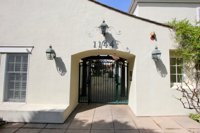 Entrance to 1144 Yale St with lanterns on either side on a sunny day.
