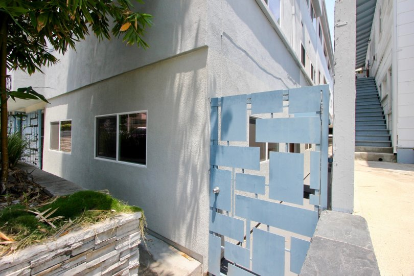 A side entrance in 1333 14th St. community with fancy blue block steel gate.