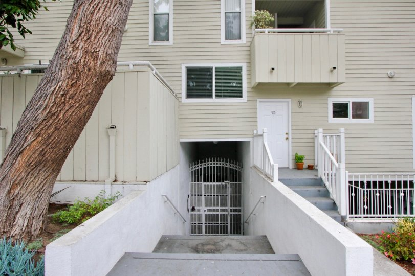 The building is shaped like a squared S. The two extensions extend into a covered patio circling around half the house. The second floor is smaller than the first, which allowed for several small balconies on one side of the house. This floor has roughly