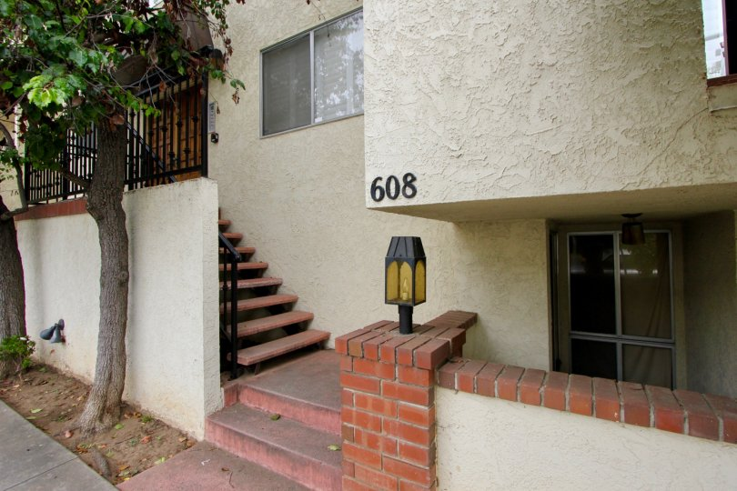 Entrance to 608 Idaho Ave with staircases and trees around it.