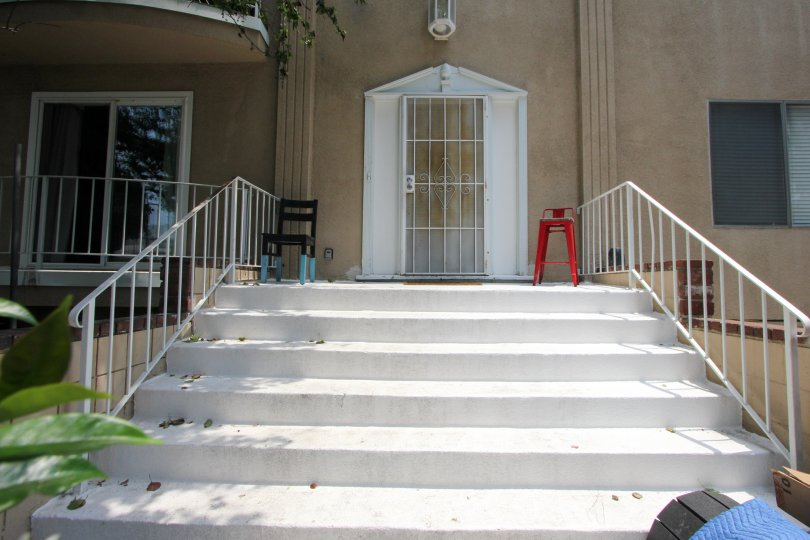 Entry of a big home with white ladders and light shade