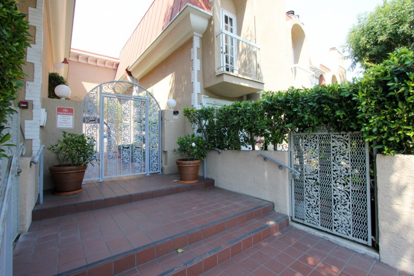 A beautiful day in the Berkeley Townhomes with white gates.