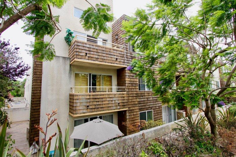 Trees in front of villa with 3 floors in Ocean Park Terrace community
