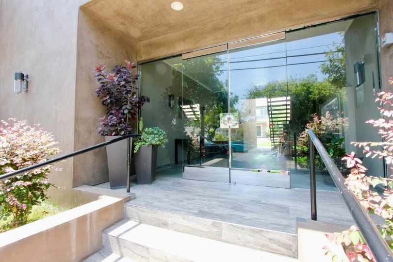 Entry of a large building in santa monica with glass doors