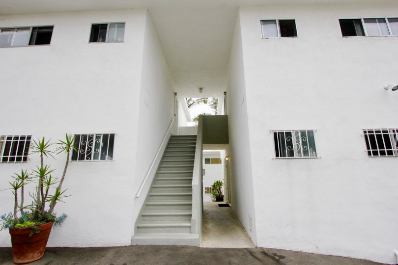 big white building with many rooms and stairs in California