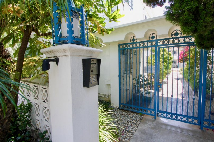 A blue gate entrance with a passcode at The Mediterranean in Santa Monica, CA