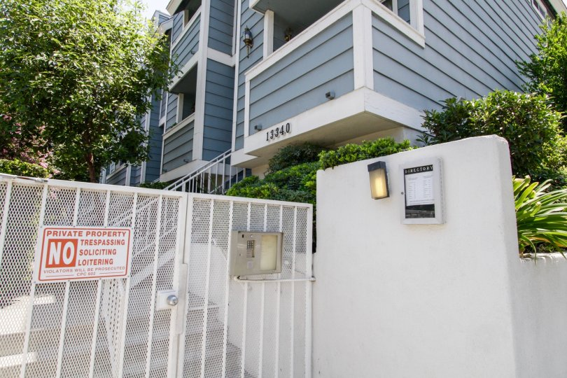 The gated entrance into Burbank Townhomes in Sherman Oaks