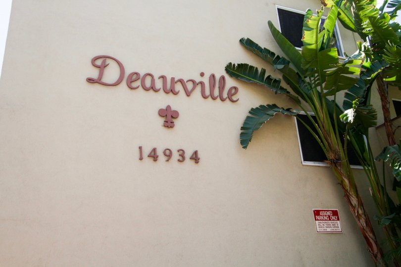 The Deauville Maison name witten on the side of the building