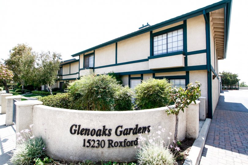 The name and address of Glenoaks Gardens at the entrance into the property