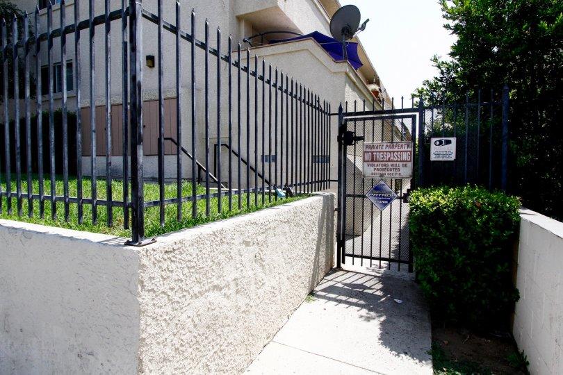 The sidewalk into Olive Tree Villas