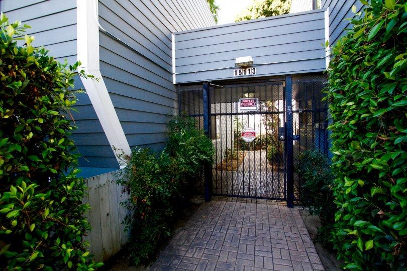 The gate into Apsen Village in Van Nuys