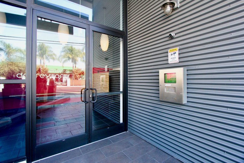 large walls with door of glass on entry of building in California