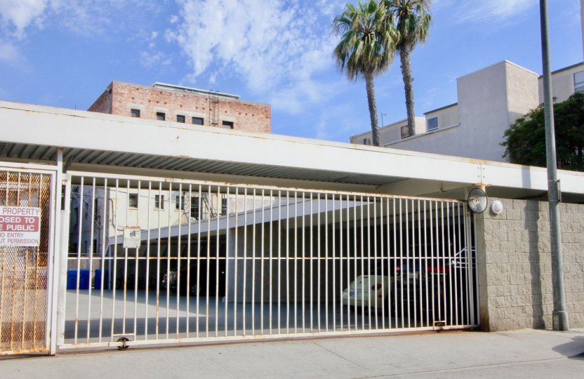 sunny weather with large gate of metal of a big building in California