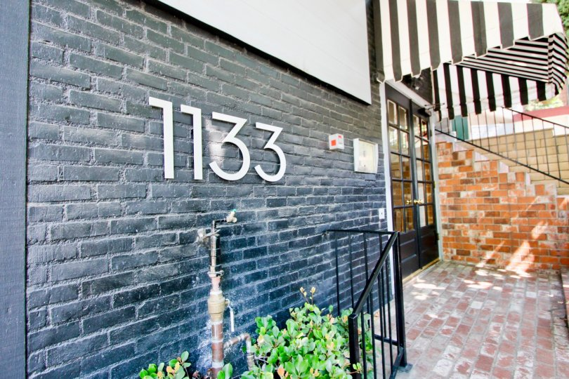 classy signage of 1133 Clark amidst its brick styled design, West Hollywood, California