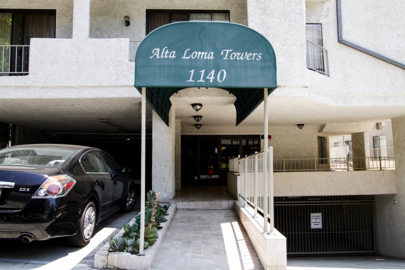 The address of Alta Loma Towers at the entrance