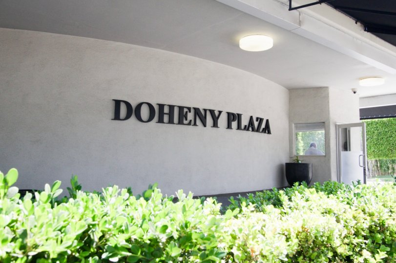 The Doheny Plaza name written on the building