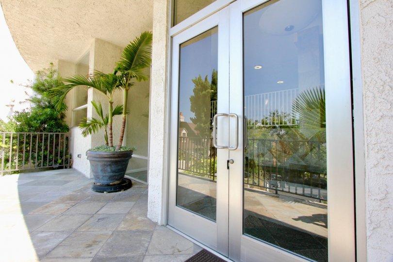 the front door of a house with glass door in horn plaza