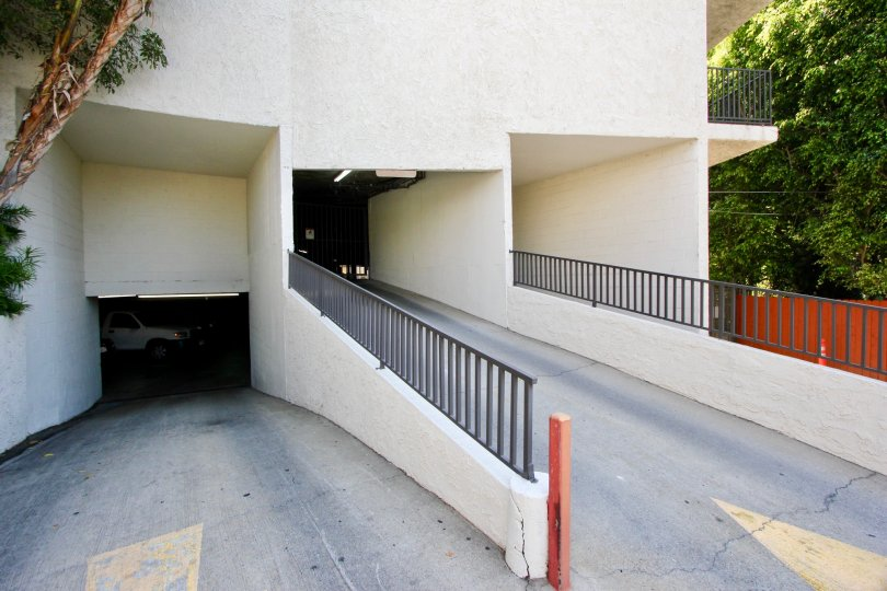 The shady driveway and entrance ramp at Horn Plana in West Hollywood.
