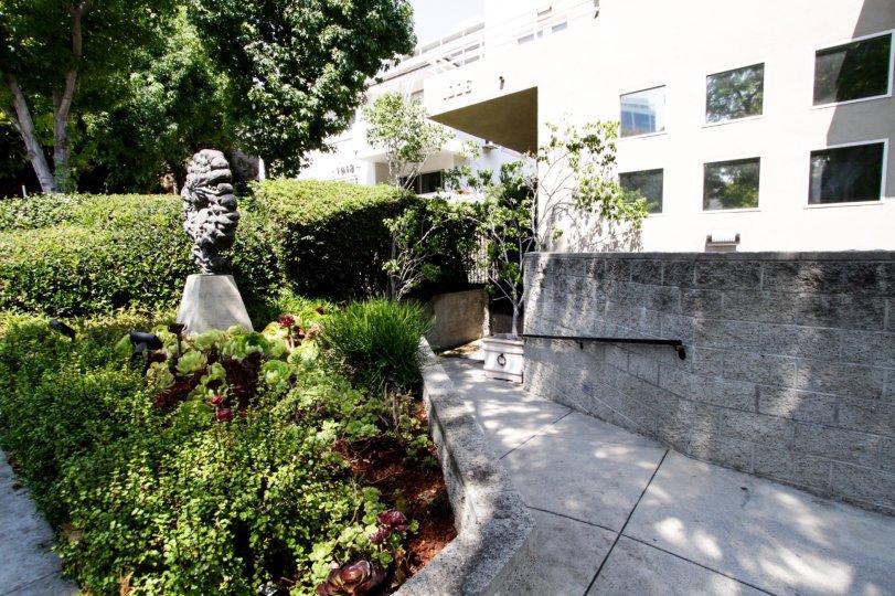 The statue in the Nouveau West Villas landscaping