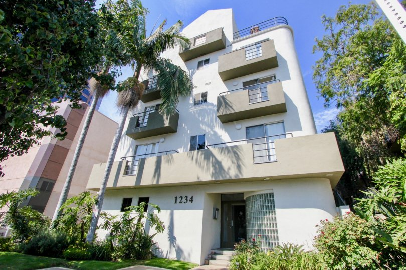 1234 Granville, west la, California is A beautiful sky high well construct building which have elegant colour and shiny bright glass windows. Lots of green trees enhance its beauty. A sunny bright day give it an amazing look.