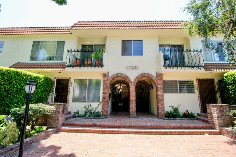 A sunny day at 1323 Carmelina, with Spanish-style flare and green hedges