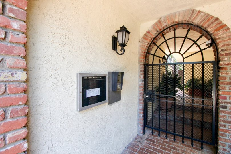 the front door of a house in the 1323 Carmelina in a sunny day