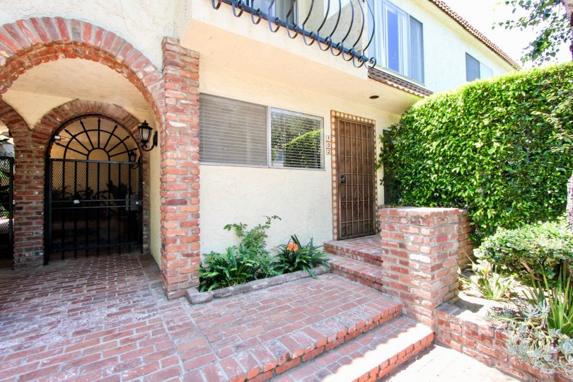 A sunny porch with well kept bushes at 1323 Carmelina in West LA.