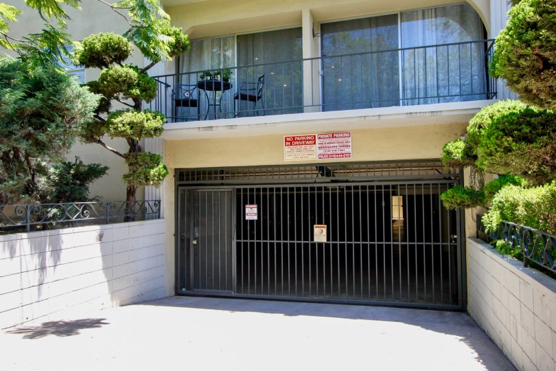 Daytime view of garage gate and trees at 1410 Bentley in sunny West LA, California.