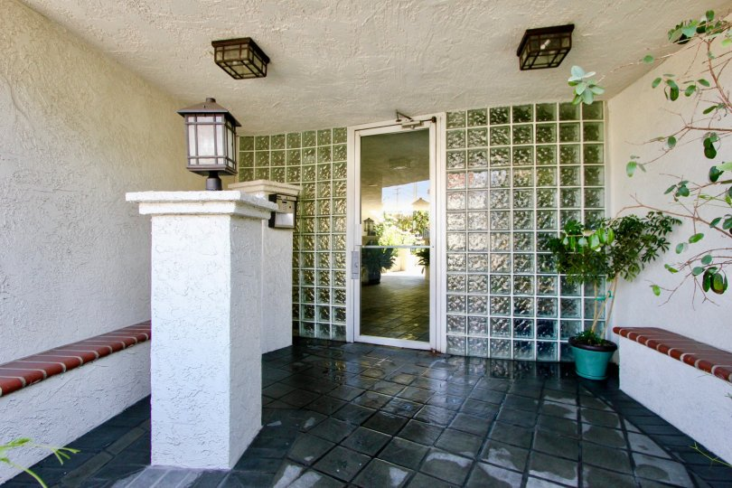 A covered patio area featuring an opaque glass wall in the 1741 Granville community of West LA, California.