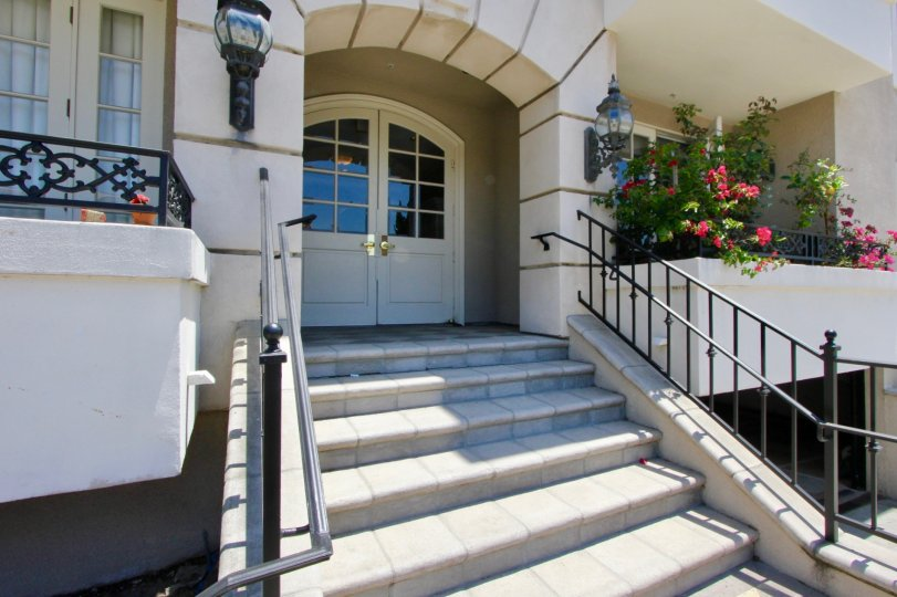 View of front door and steps, balconies and plants at 1818 Colby in sunny West LA, California.