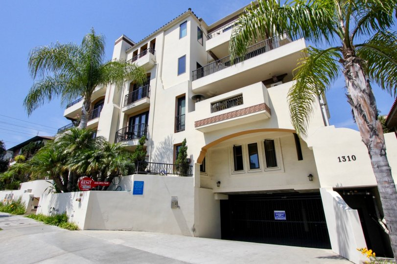 An apartment building complex for rent in the West LA, California community of Armacost Villas surrounded by palm trees
