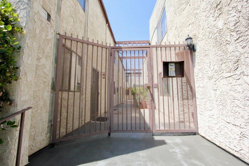 amazing white walls and gate of Barrington Gardens, West La, California