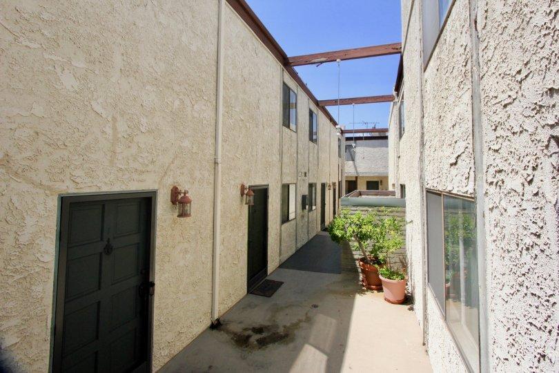 A sunny day at Barrington Gardens with an apartment building.