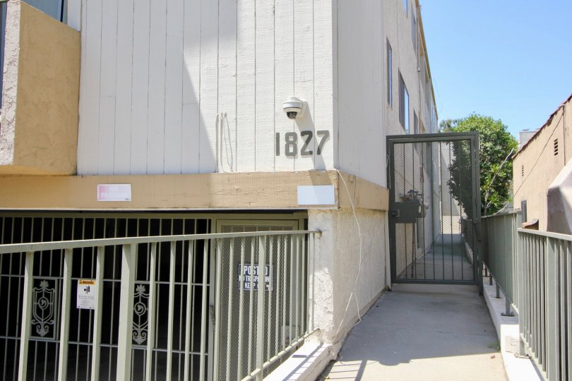 A very rare view of the security entrance an of 1827 Barrington West Gardens Apartments, West LA, California