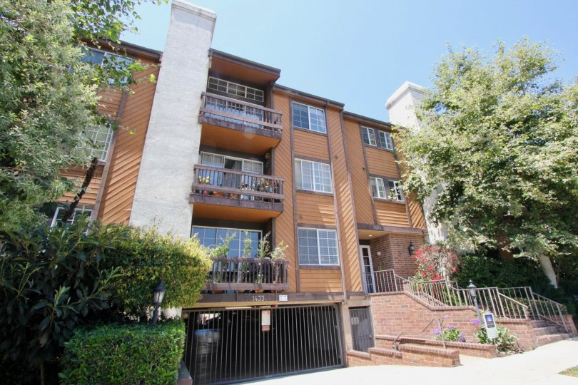 Tall modern architecture and beautiful landscaping adorns this 3 level condo with an underneath parking garage