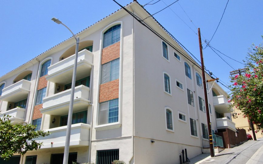 Street view of the beautiful and tall Colby Regency apartment, West La, California