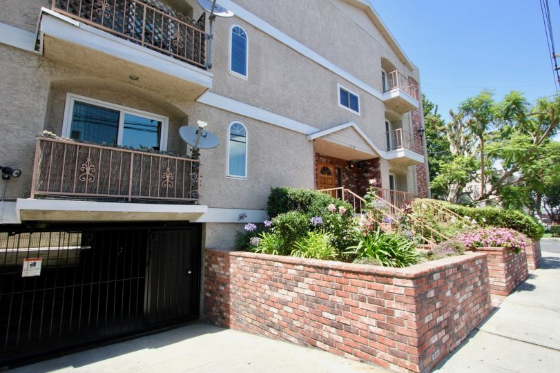 Landscaped balcony, landscaping and gated parking garage at Colonial Regency in West LA