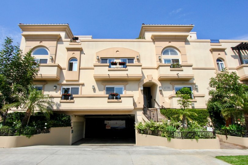 ground area with parking facility is available in house and house in balcony contains roses flowers